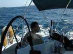 Jeff concentrates at the helm as we sail out into pretty good tradewinds