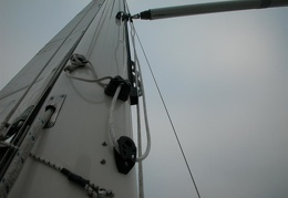 The butt end of the pole is attached to a track on the front of the mast where the pole stores