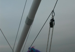 The downhaul block attached to the bridle (now its at the end of the pole)